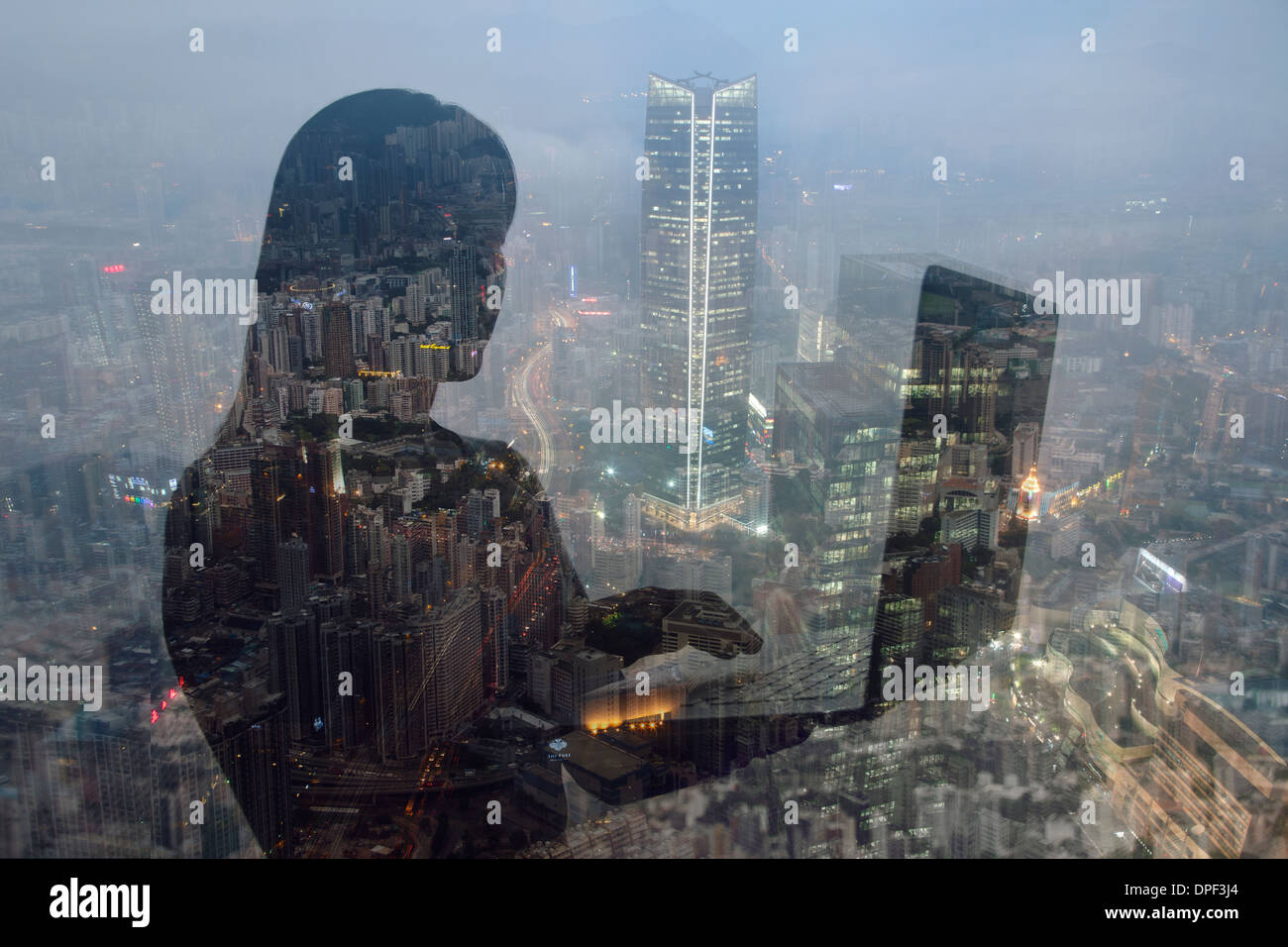 Businesswoman using laptop and Hong Kong cityscape, composite image - Stock Image