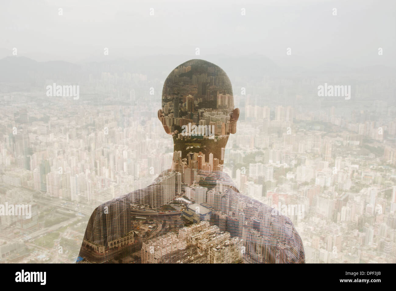 Businessman and Hong Kong cityscape, composite image - Stock Image