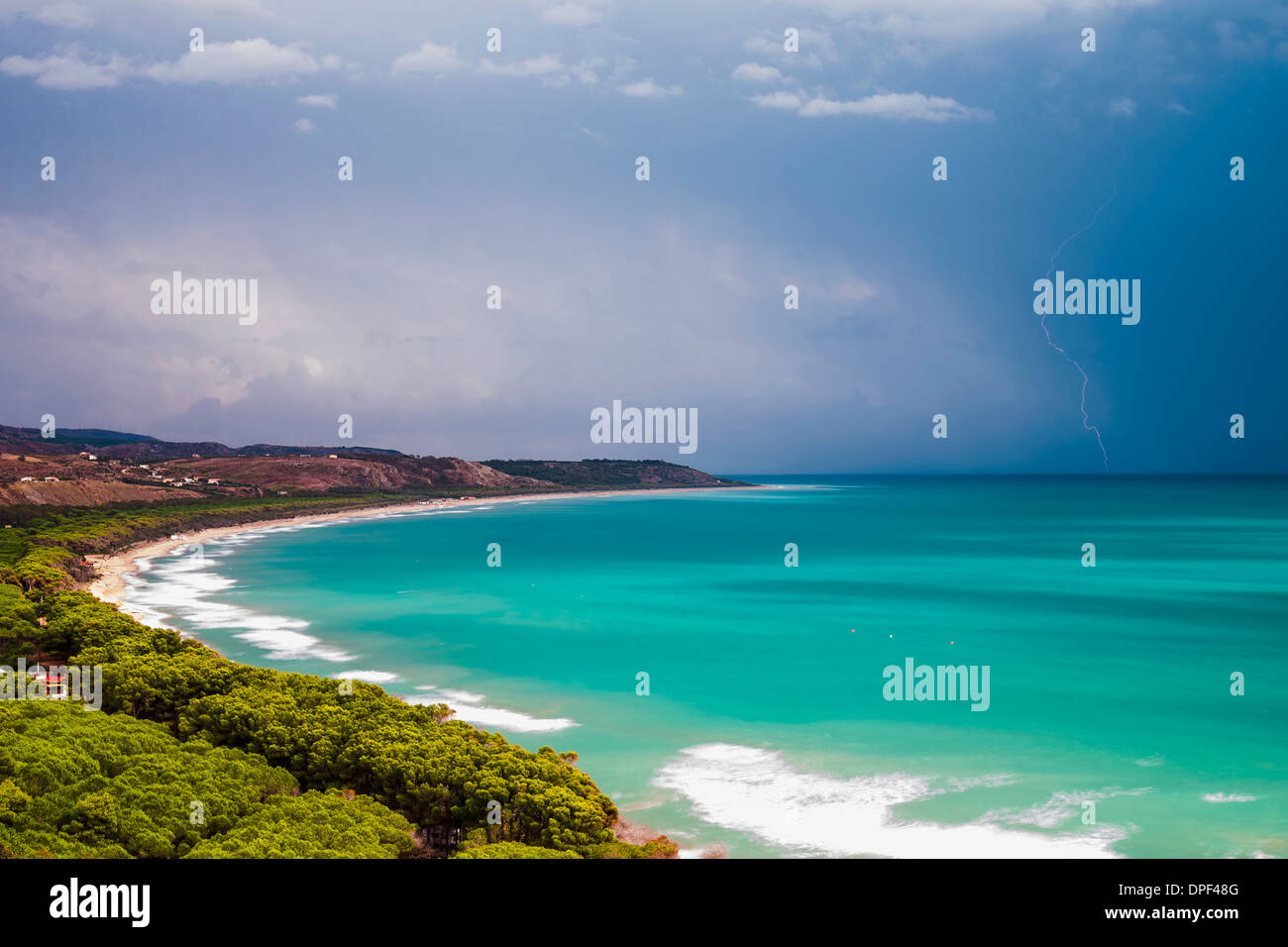 Thunder and lightning storm over Capo Bianco Beach and the Mediterranean Sea in the Province of Agrigento, Sicily, Stock Photo