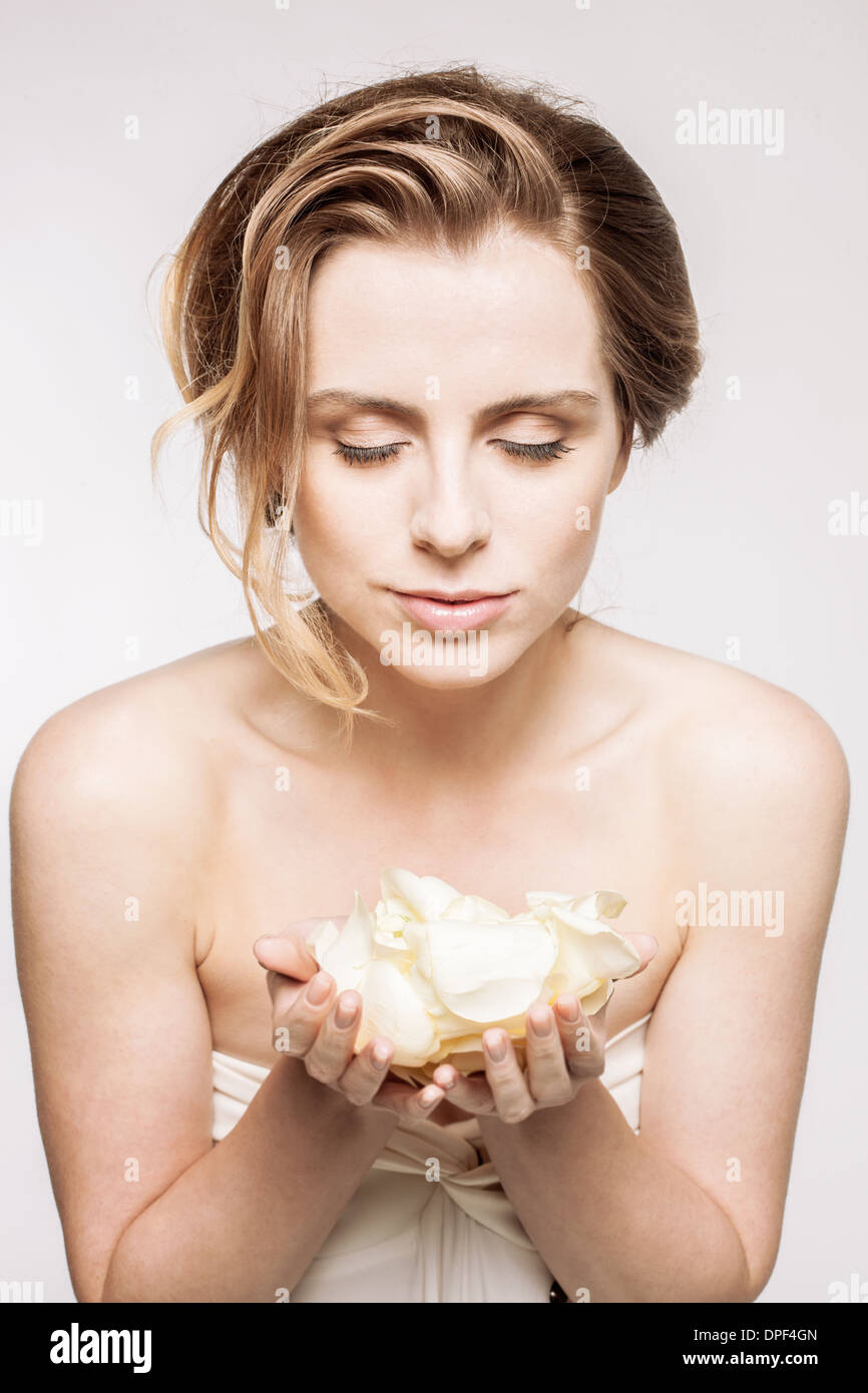 Model with handful of petals - Stock Image