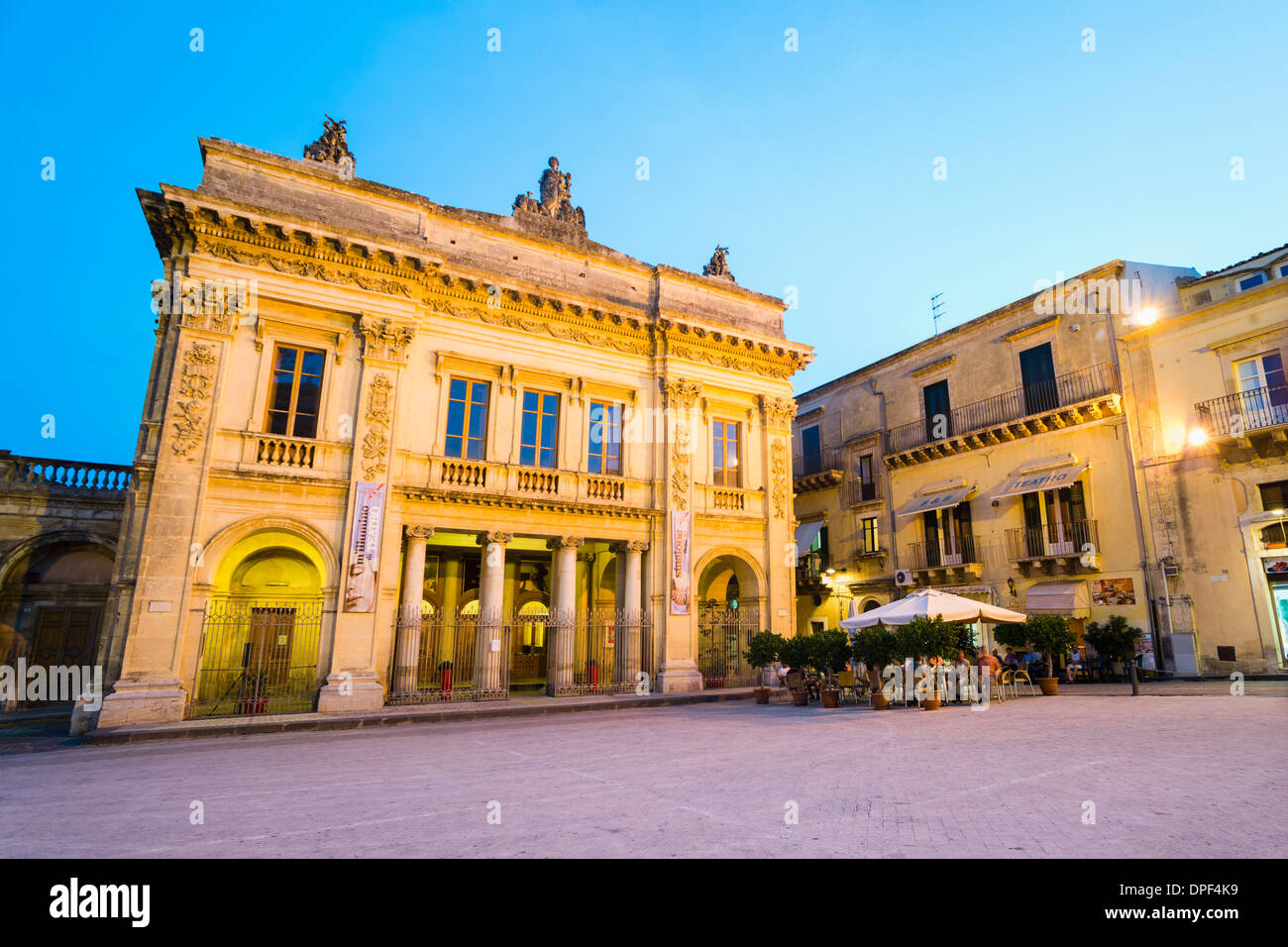 Noto Theatre and cafe at night in Piazza XVI Maggio, Noto, Sicily, Italy, Europe - Stock Image