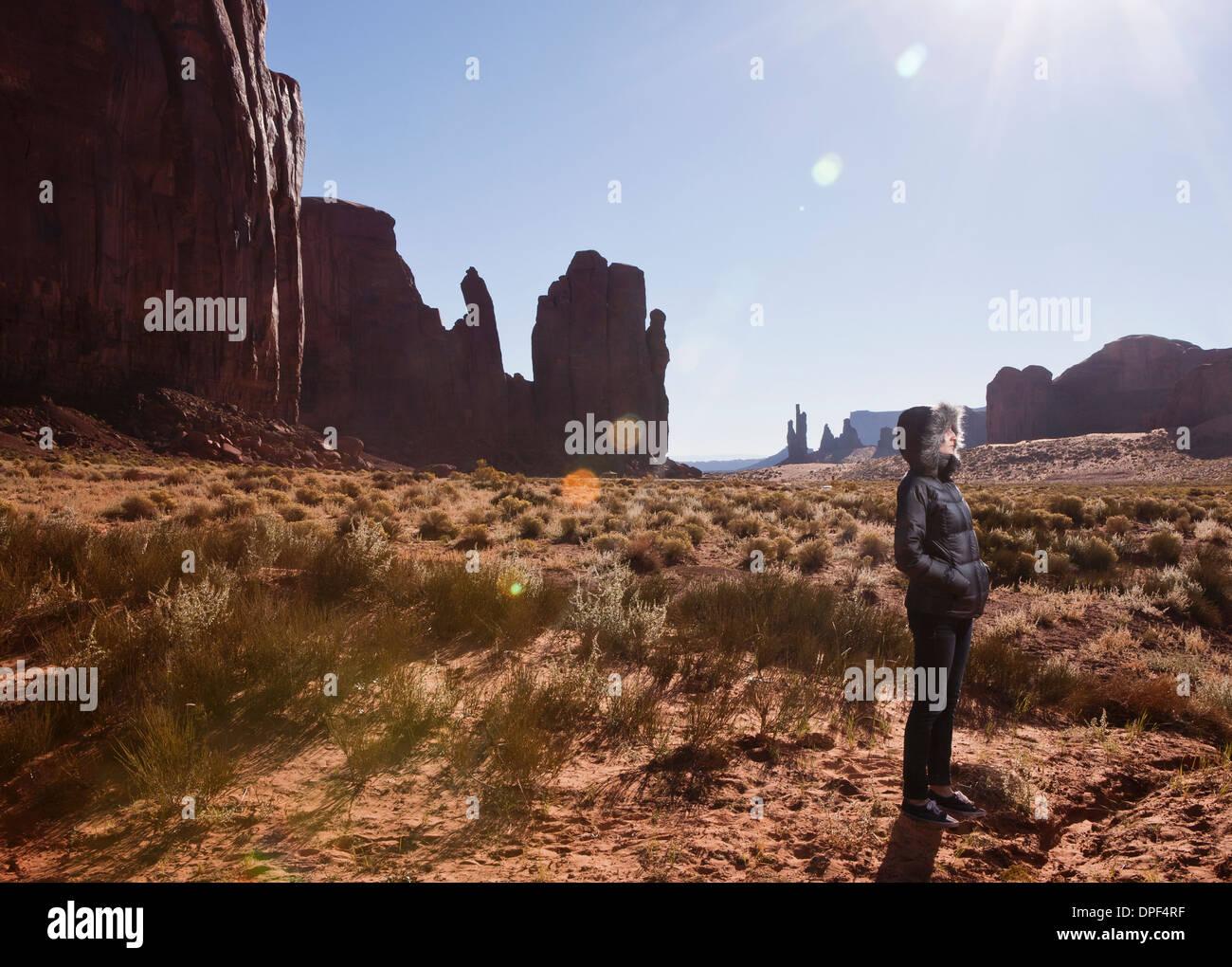 Female tourist alone in Monument Valley, Navajo Tribal Park, Arizona, USA - Stock Image