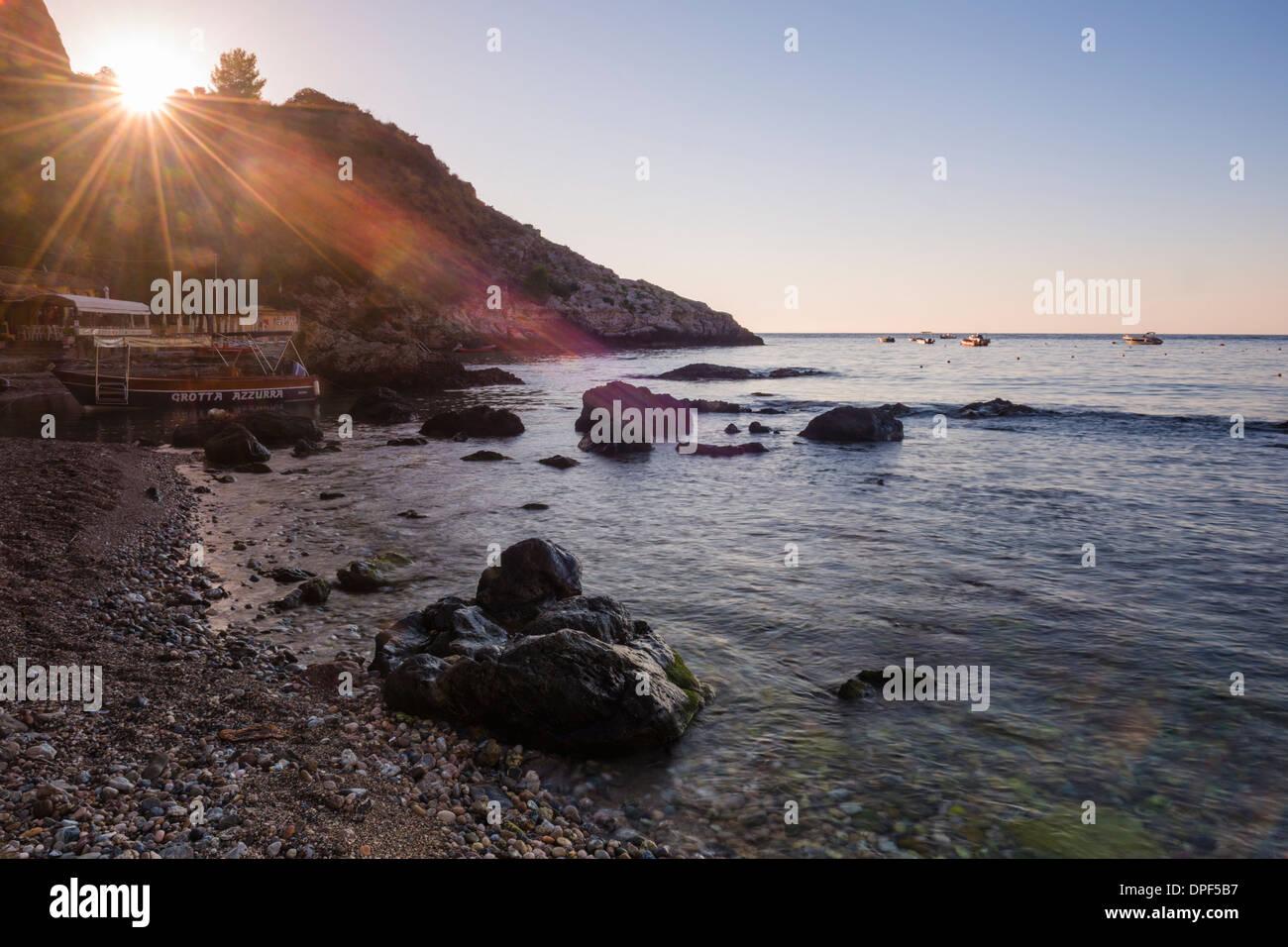 Sunstar at Isola Bella Beach at sunrise, Taormina, Sicily, Italy, Mediterranean, Europe - Stock Image
