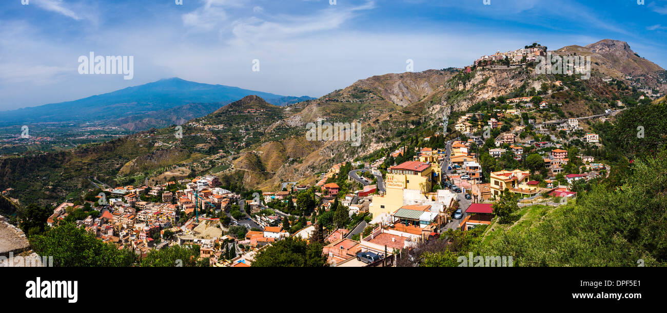Taormina and Castelmola on the right, with Mount Etna in distance, Sicily, Italy, Europe - Stock Image