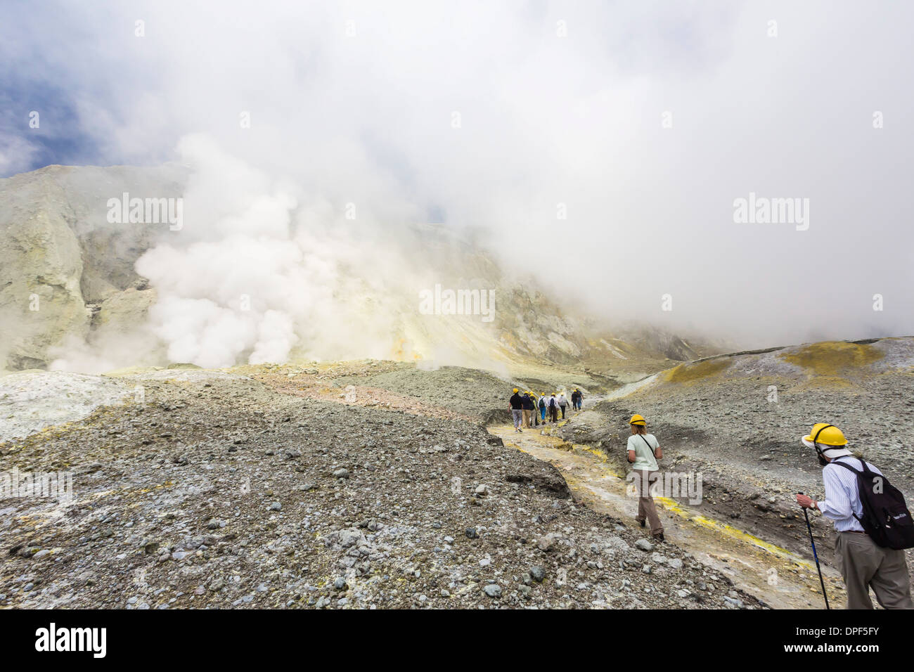 Visitors at an active andesite stratovolcano on White Island, North Island, New Zealand - Stock Image