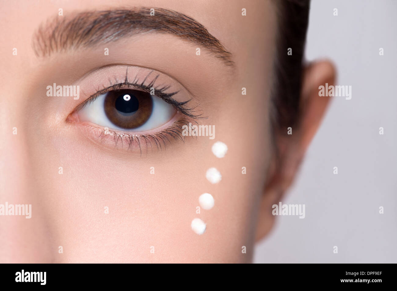 Cropped studio shot of young woman's eye - Stock Image