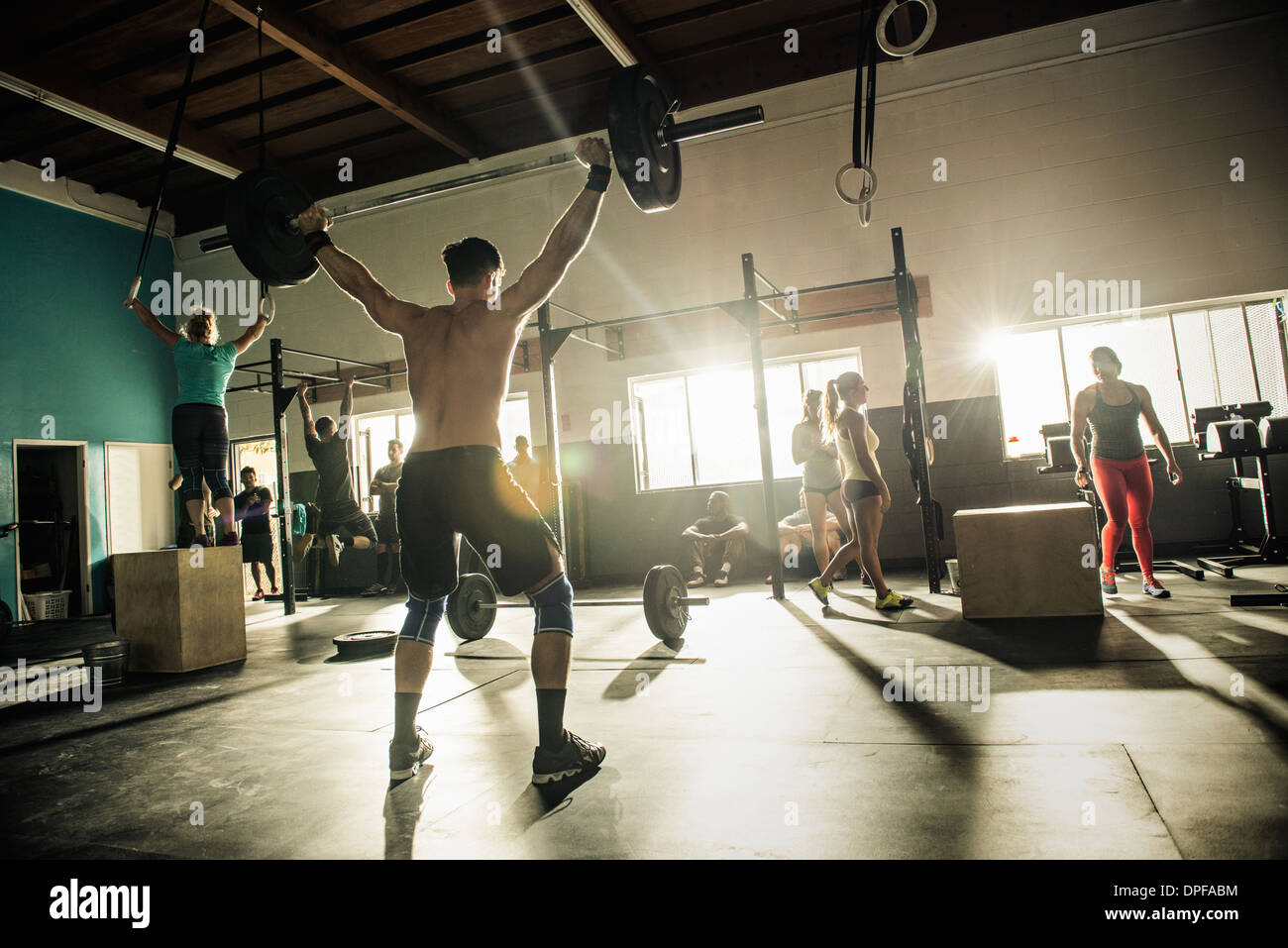 Group of people training in gymnasium - Stock Image
