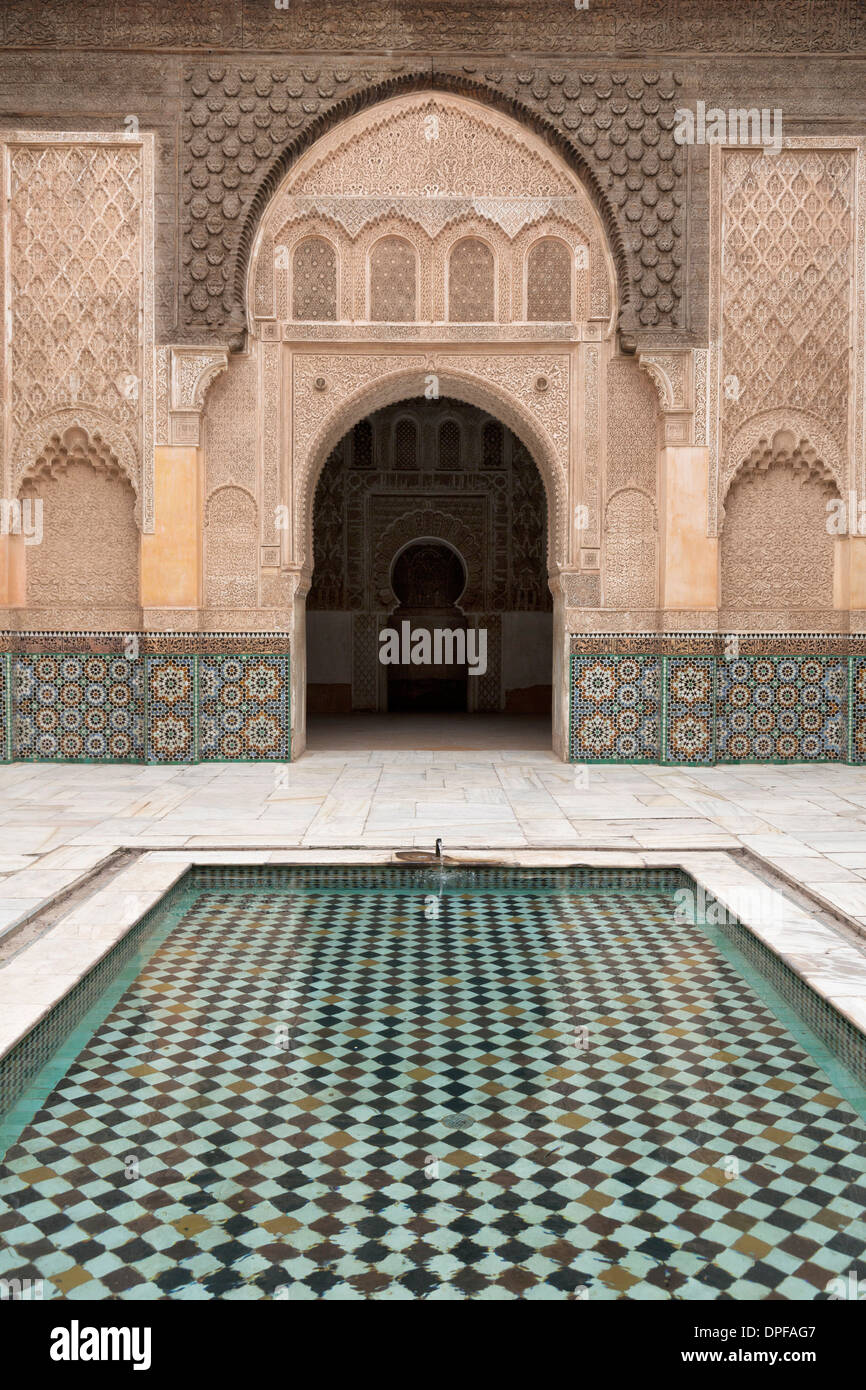 Courtyard and pool with traditional Moroccan ornate doorway in the Ben Youssef Medersa, UNESCO Site, Marrakech, Stock Photo