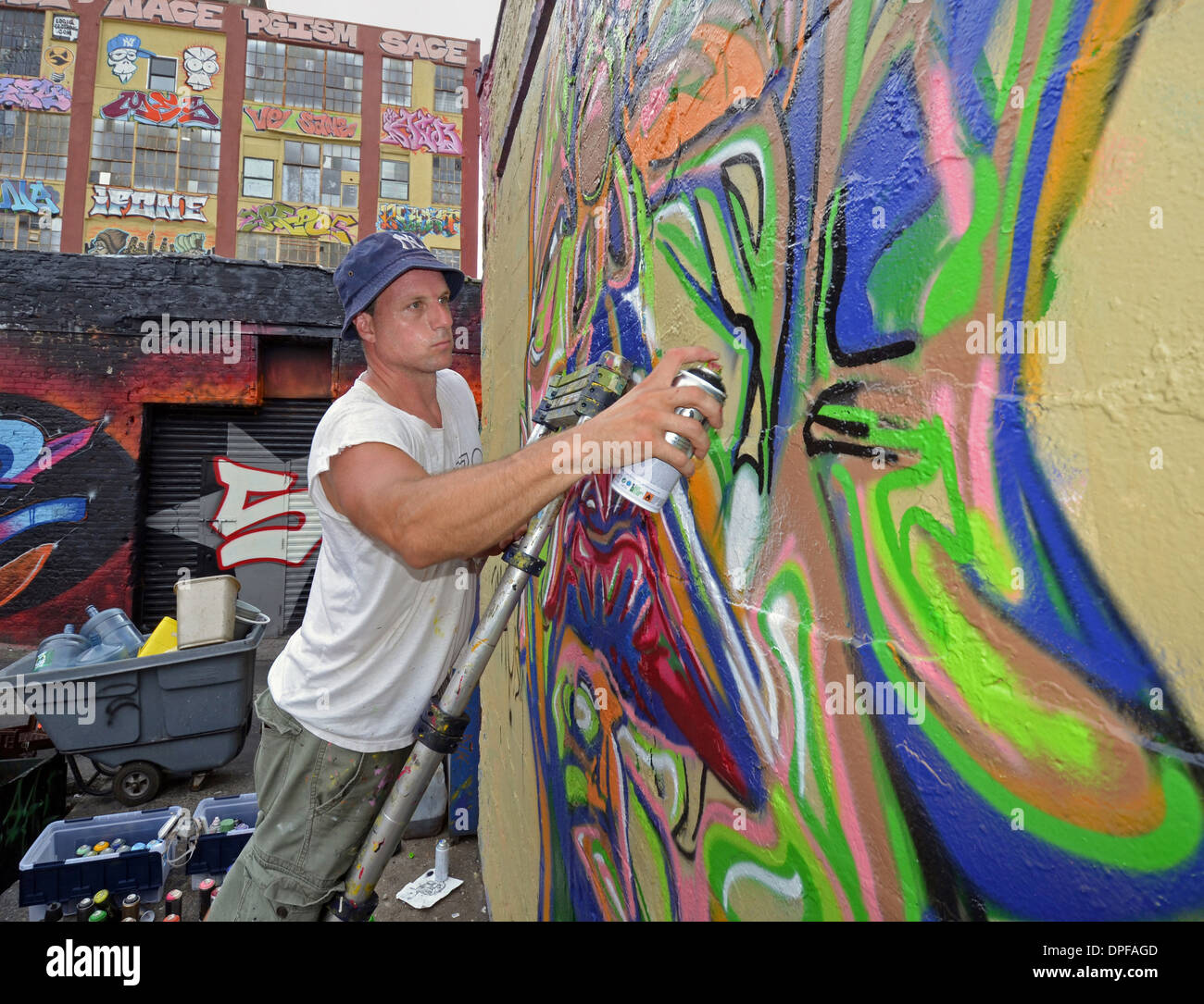 Portrait of graffiti artist working on a piece at 5 Pointz in Long Island City, Queens, New York - Stock Image