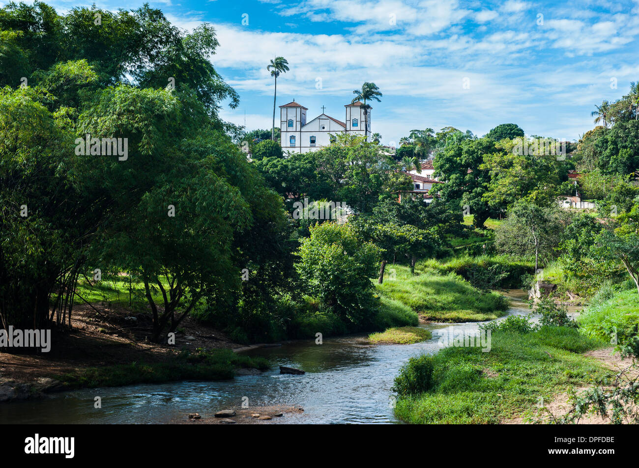 Matrix Church of Our Lady of the Rosary behind a pretty lush landscape in the historic village of Pirenopolis, Goais, Brazil - Stock Image