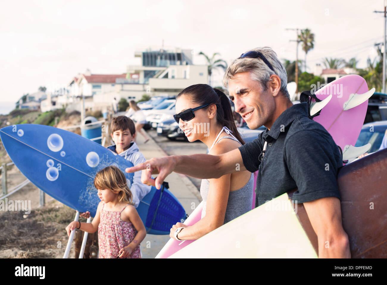 Family at coast with surfboards, Encinitas, California, USA - Stock Image