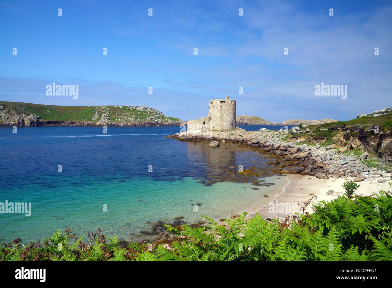 Cromwell's Castle in summer sunshine, Isle of Tresco, Isles of Scilly, United Kingdom, Europe - Stock Image