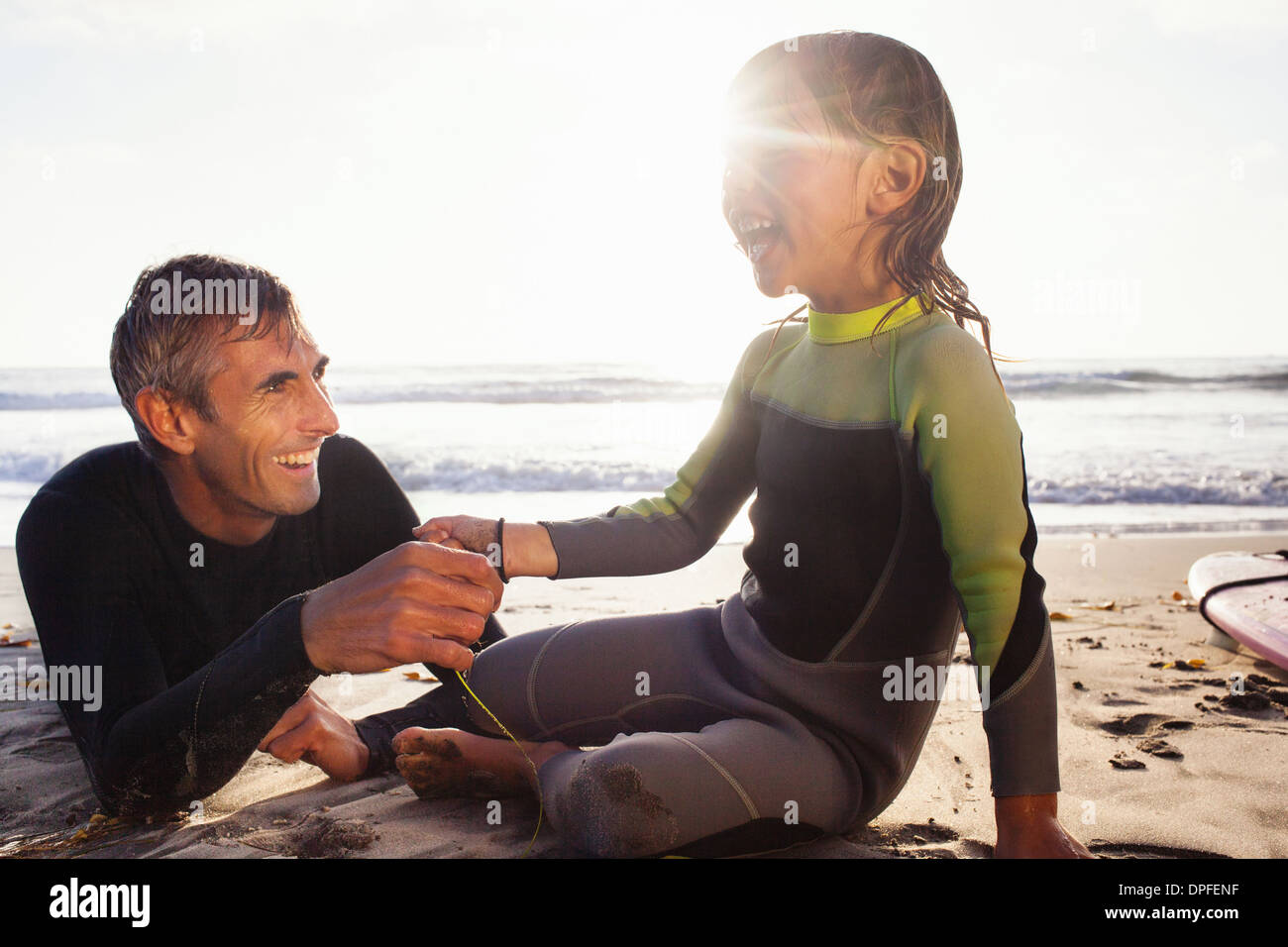 Father and daughter holding hands on beach, Encinitas, California, USA - Stock Image