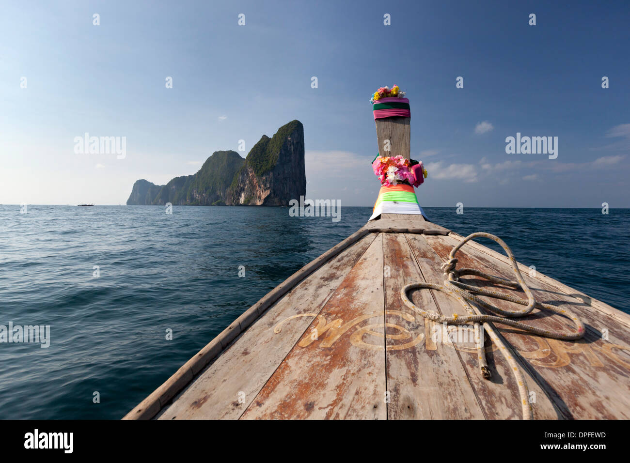 Long-tail boat and Phi Phi Lay Island, Krabi Province, Thailand, Southeast Asia, Asia - Stock Image