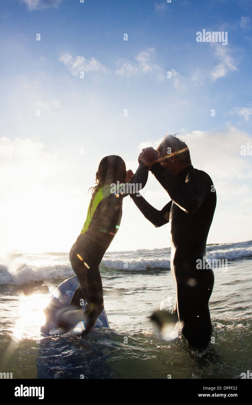 Father and daughter playing in sea, Encinitas, California, USA - Stock Image