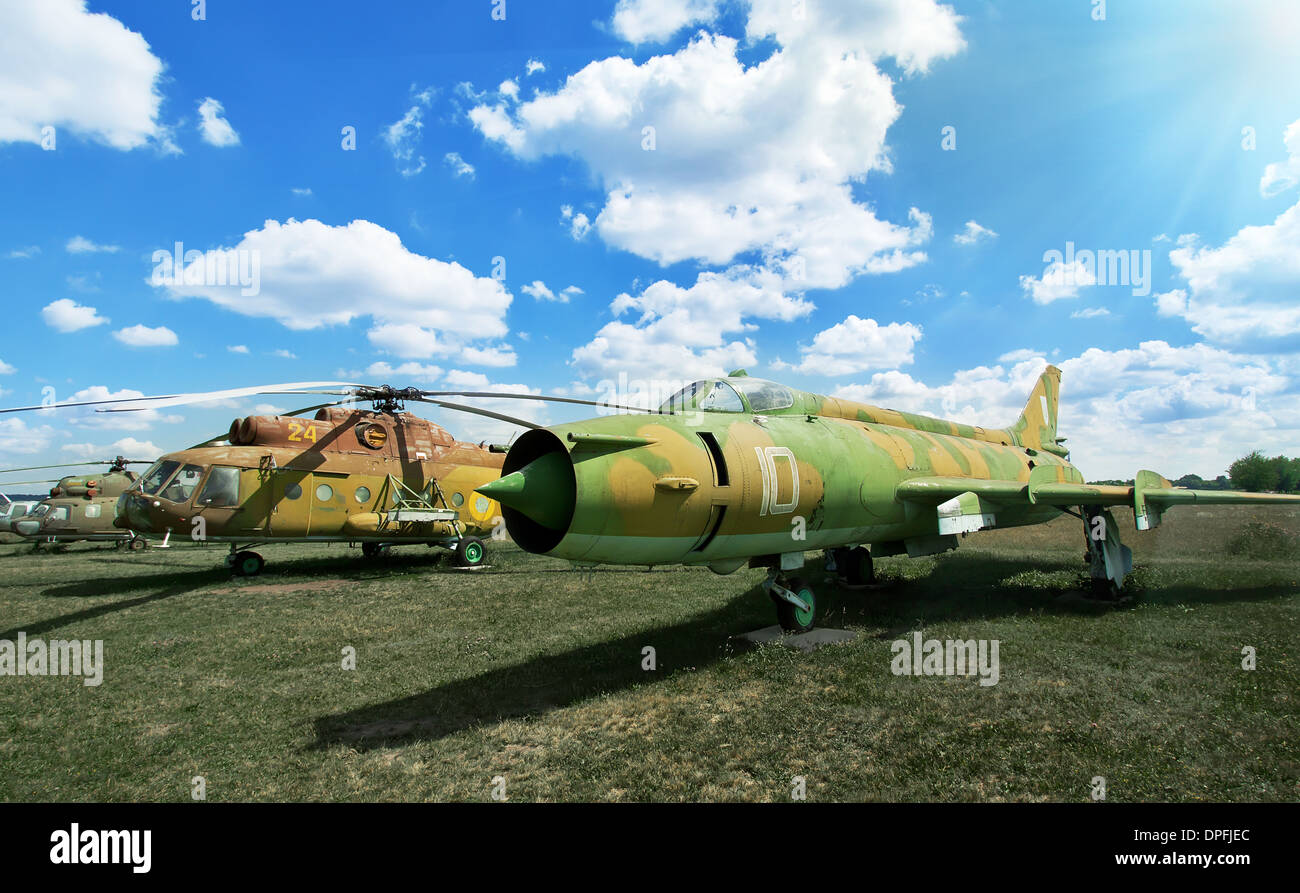 Old military plane and helicopter at the airport Stock Photo