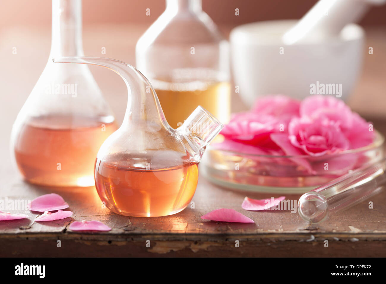 aromatherapy and alchemy with pink flowers - Stock Image