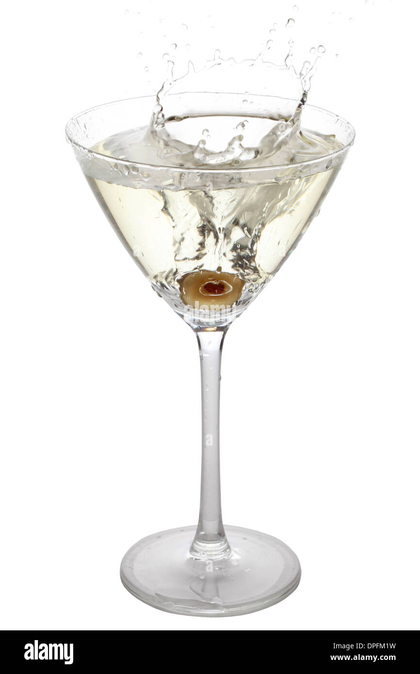 Green Olive splashing into a cocktail glass, isolated on white - Stock Image