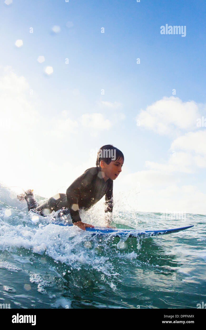 Young boy practicing on surfboard, Encinitas, California, USA - Stock Image