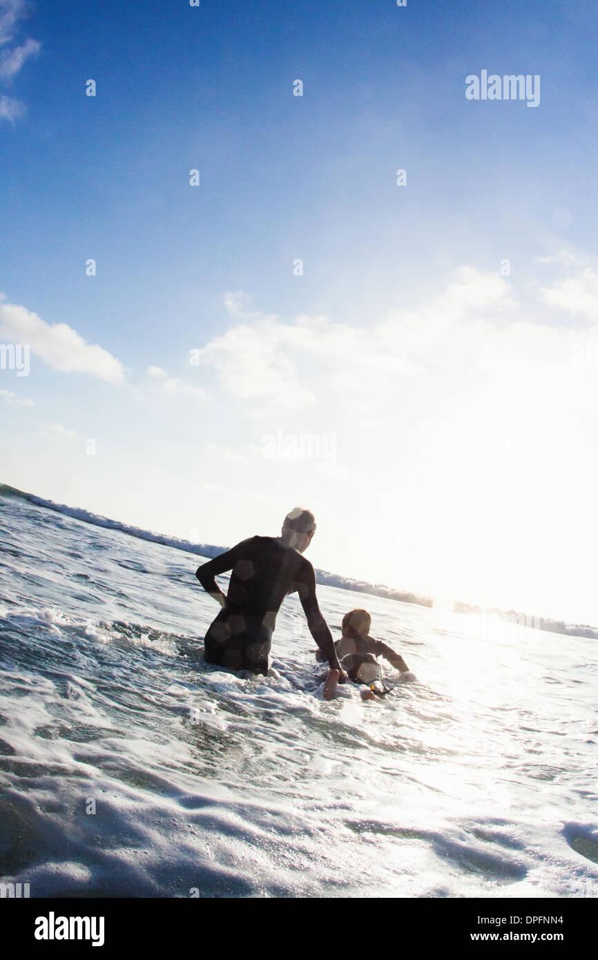 Father and son with surfboard on sea, Encinitas, California, USA - Stock Image