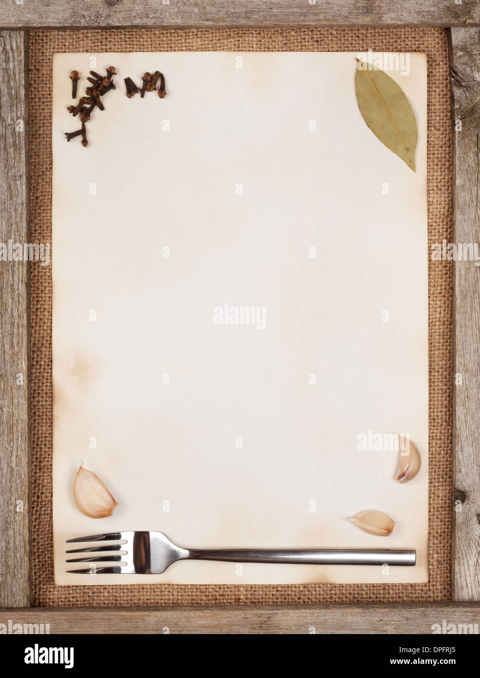 Sheet of paper with spices in a frame of boards - Stock Image