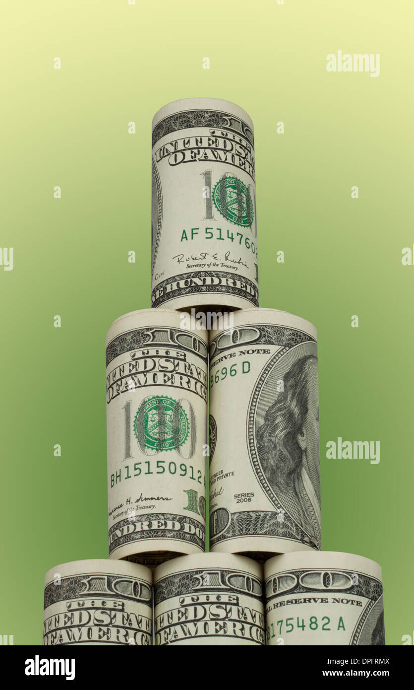 The rising pyramid of hundred dollar bills on white background - Stock Image