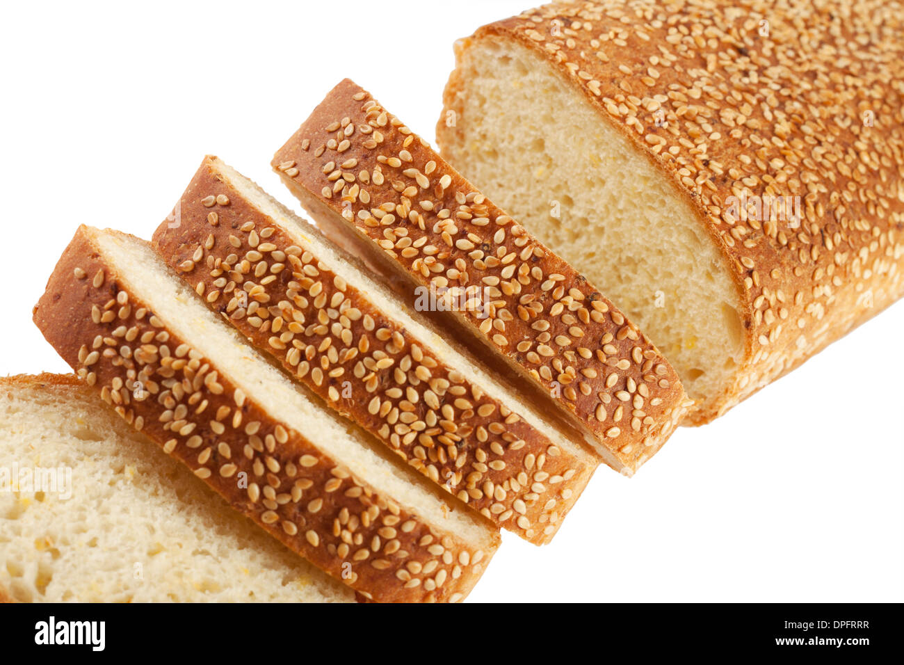 Slices of white bread with sesame seeds isolated on white background - Stock Image