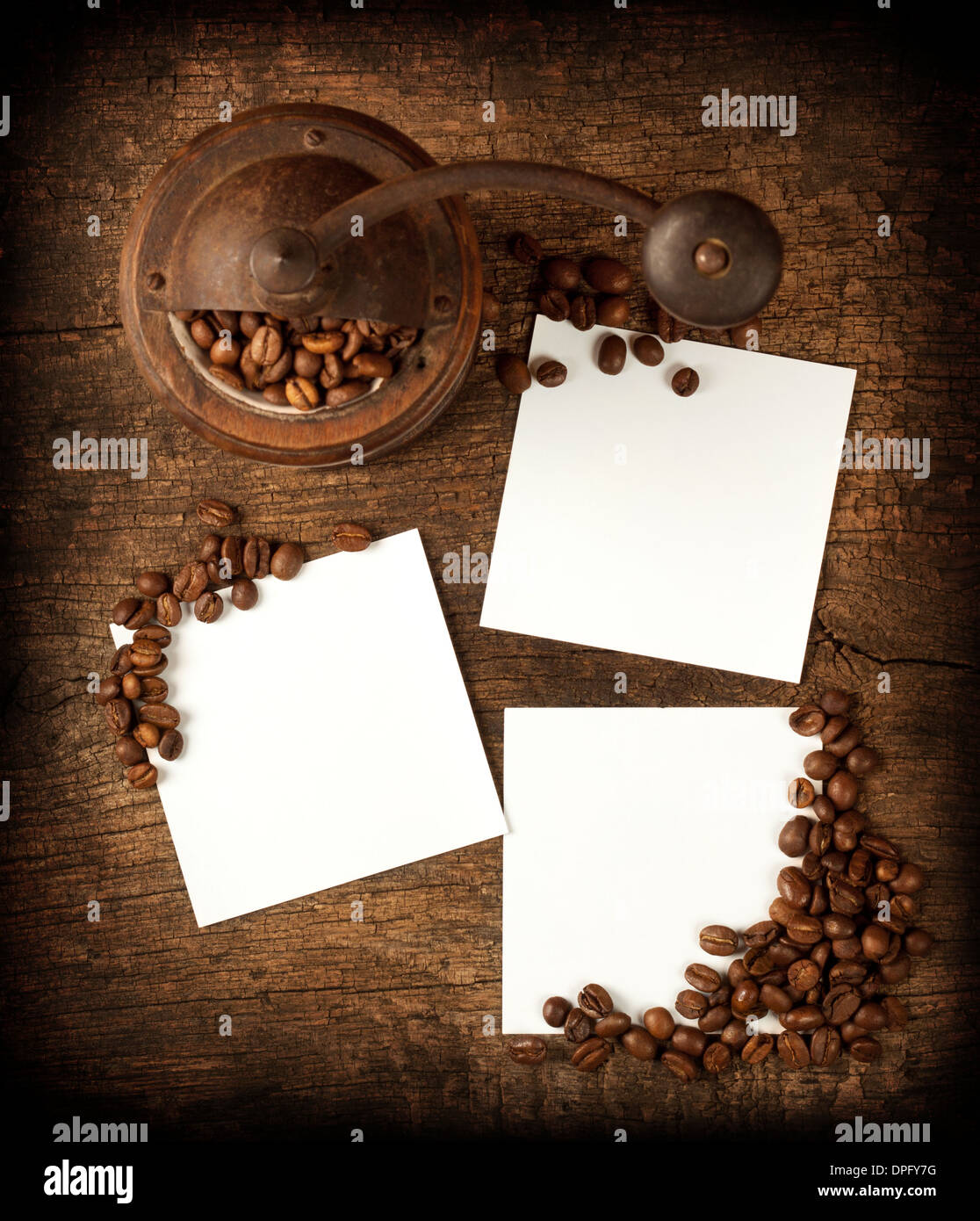 Three square sheet on a wooden background with coffee - Stock Image