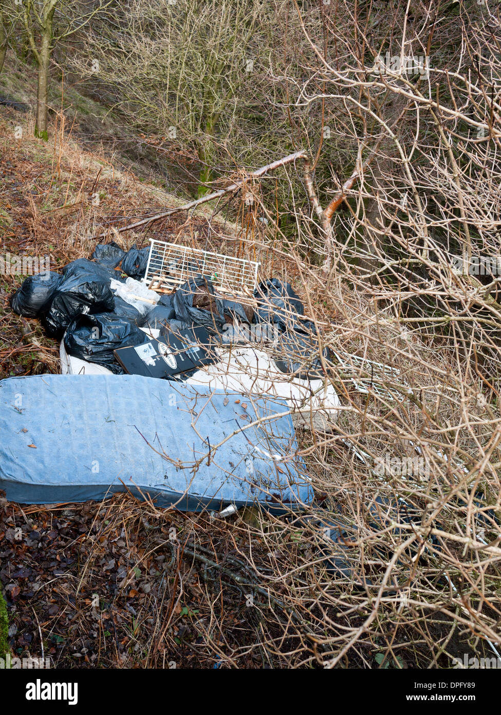 Rubbish dumped in countryside UK. - Stock Image