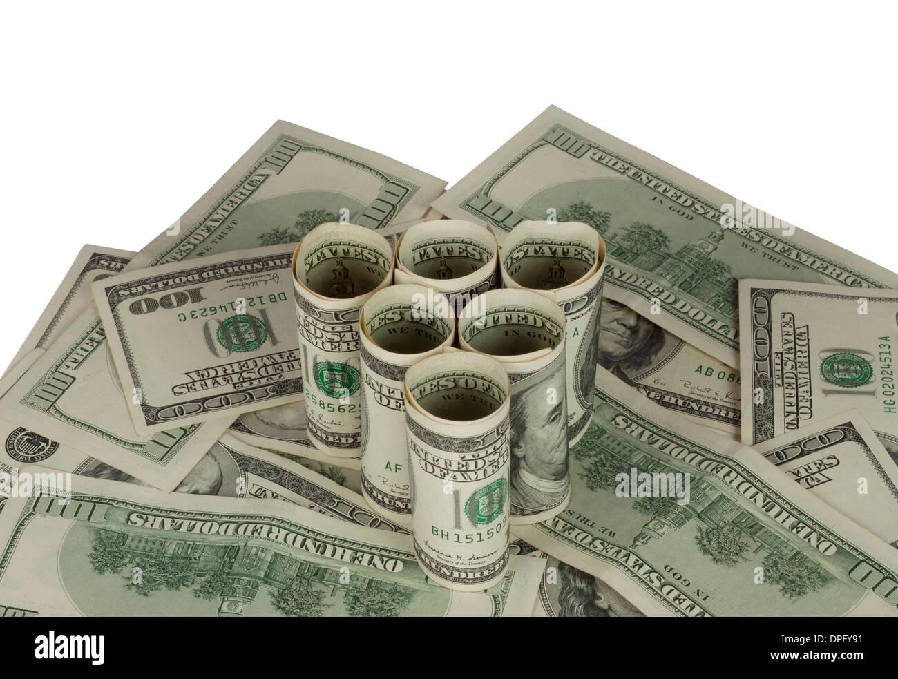 Triangle of hundred dollar bills on white background - Stock Image