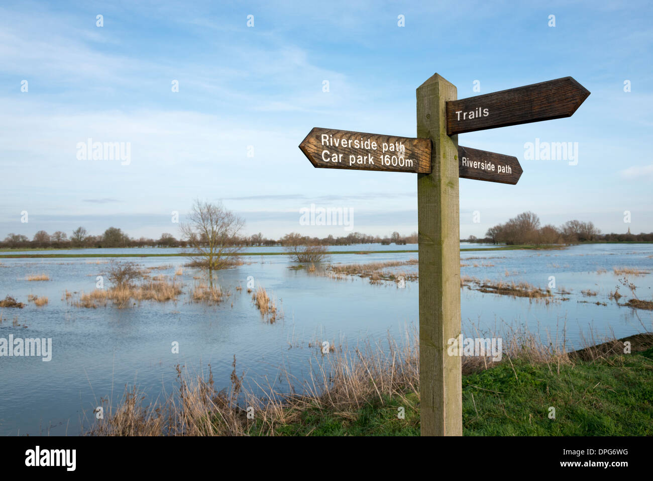 a direction signpost for a riverside footpath in cambridgeshire uk