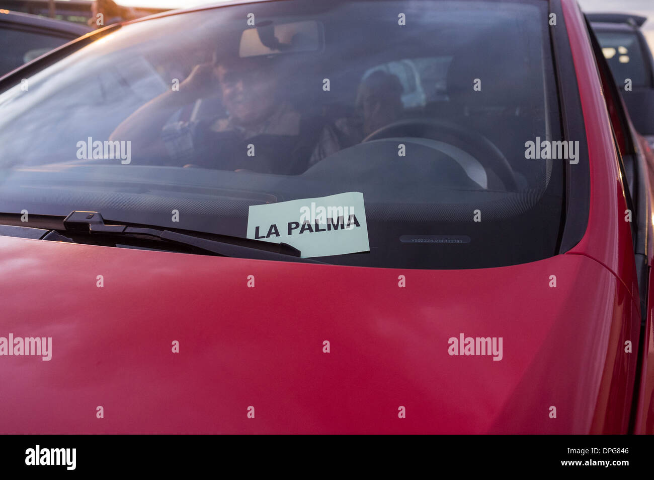 La Palma ticket tucked under windscreen wiper of car waiting to embark on the Fred Olsen ferry at los Cristianos, Tenerife, - Stock Image