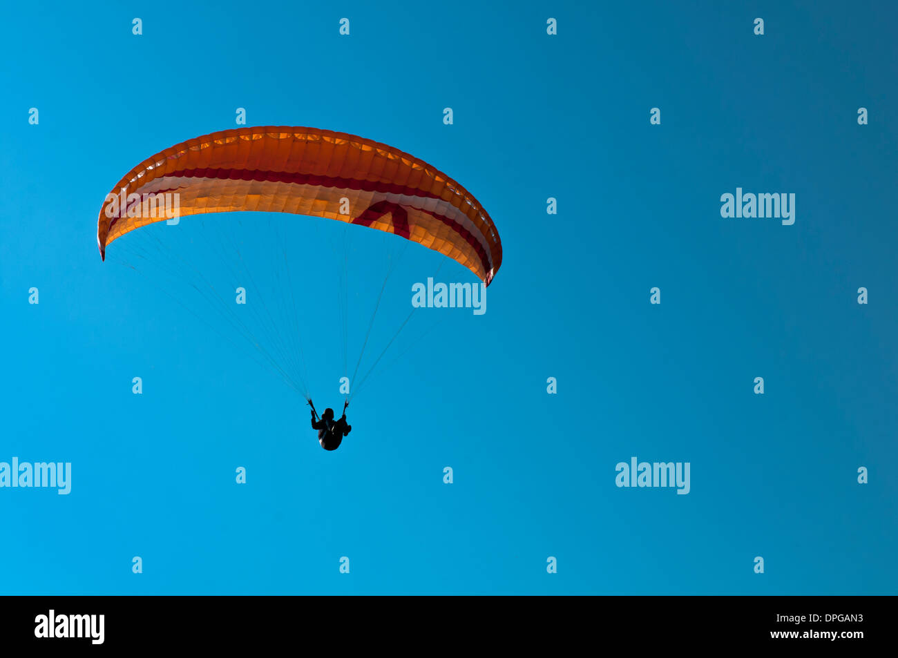 Paraglider on landing approach - Stock Image