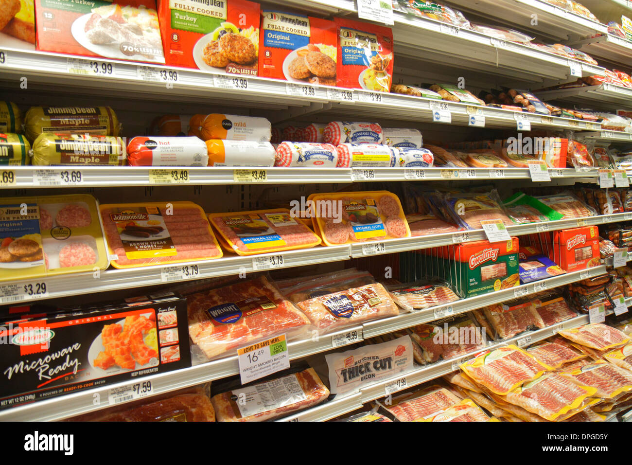Miami Homestead Florida Publix grocery store supermarket food shopping retail display sale packaging meats sausages bacon - Stock Image