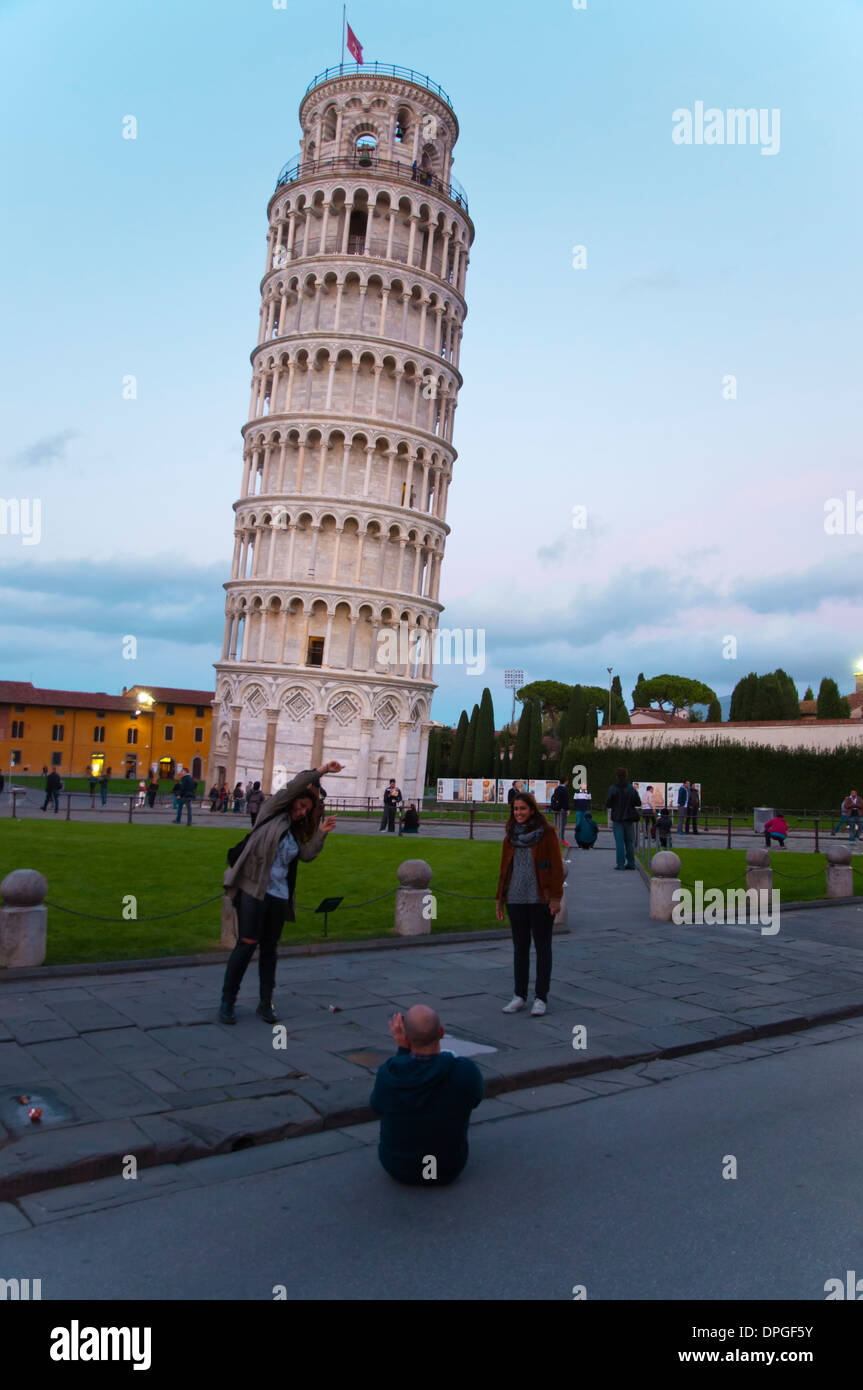 Tourists taking photos and posing in front of Torrre Pendante the leaning tower at Campo dei Miracoli the field Stock Photo