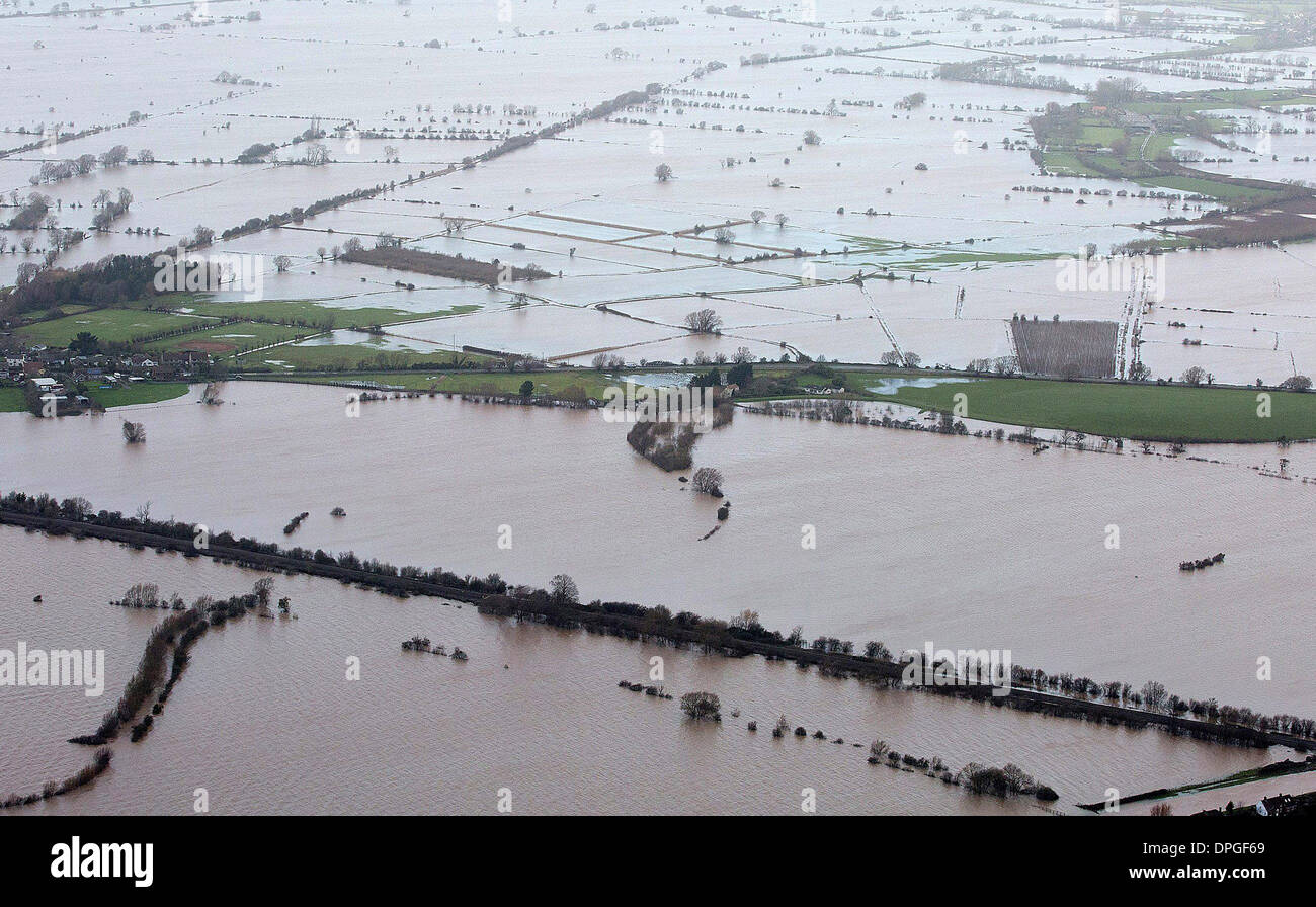 Aerial view of a house on the Somerset levels protected by a flood barrier. - Stock Image