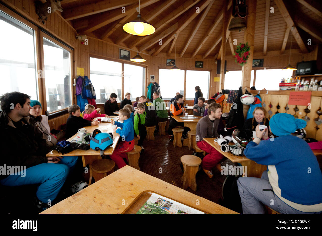 Skiers in a restaurant on the piste drinking and eating, Plan de Croix, Les Portes du Soleil, Swiss Alps, Switzerland Europe - Stock Image