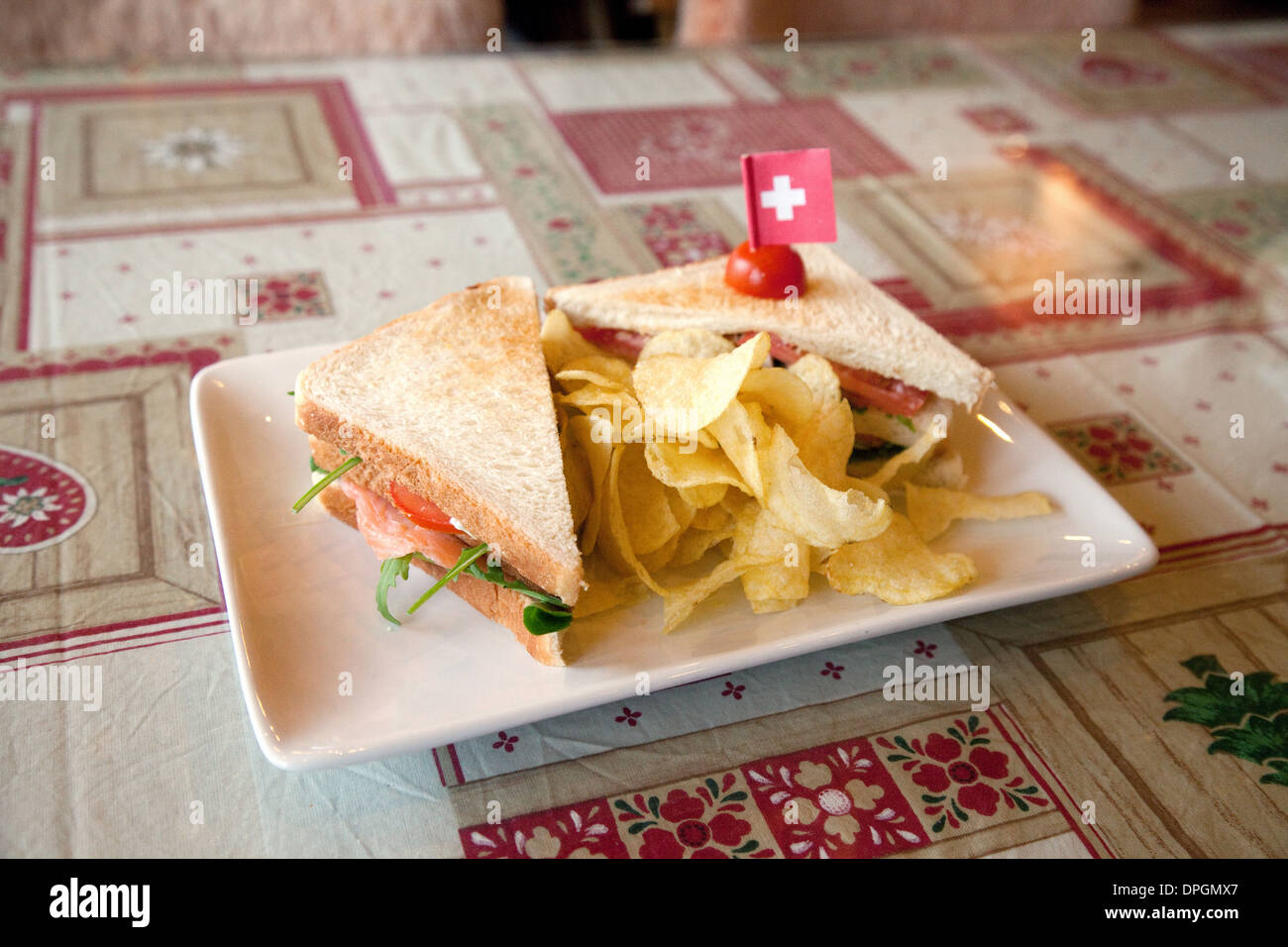 A Swiss Club Sandwich in a cafe, - Swiss food meal, Torgon, Valais, Switzerland , Europe - Stock Image