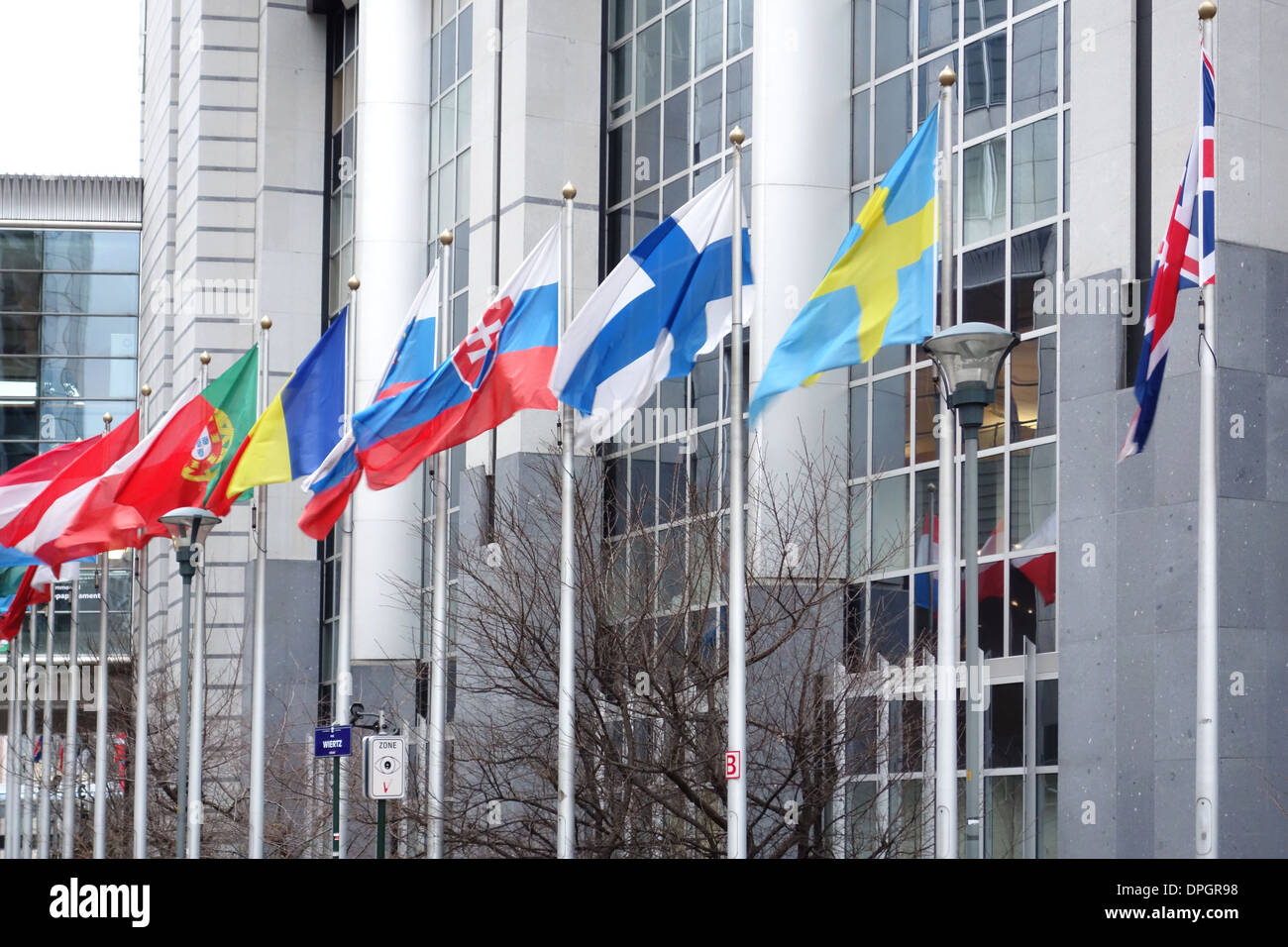 EU flags flying, in front of the European Parliament buildings in Brussels, Belgium. - Stock Image