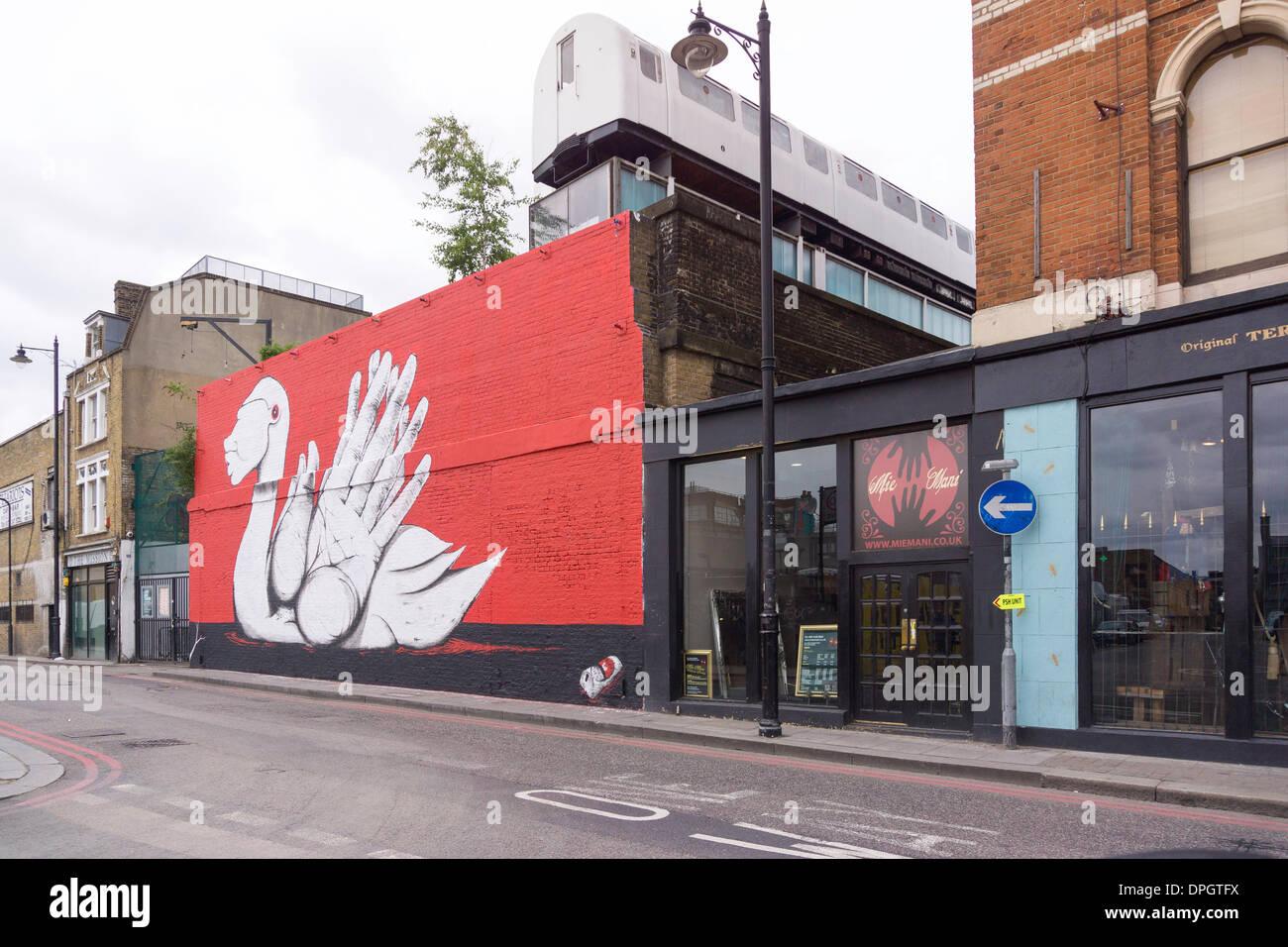 famous Graffiti art in the London district of Shoreditch, London, United Kingdom - June 2013 - Stock Image