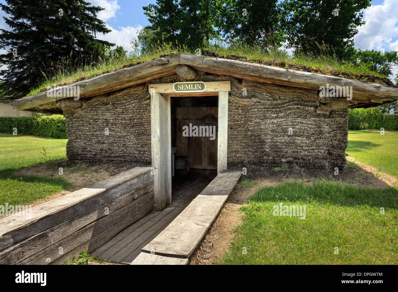 Sod house of pioneers or Semlin, Mennonite Heritage Village, Steinbach, Manitoba, Canada - Stock Image