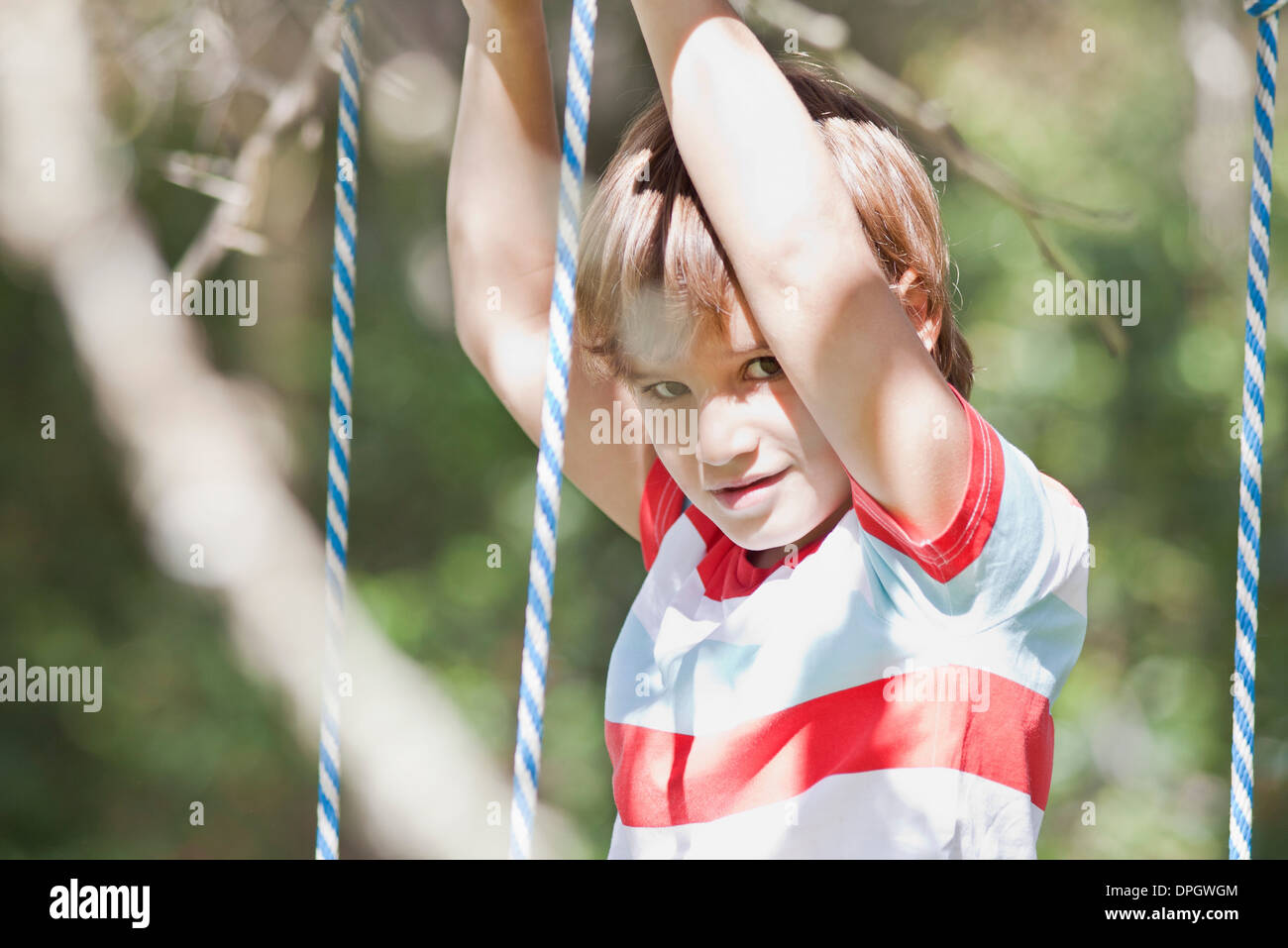 Boy on swing, portrait - Stock Image