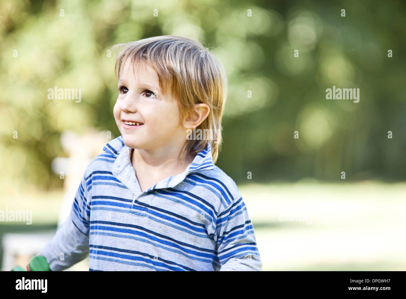Boy looking up - Stock Image