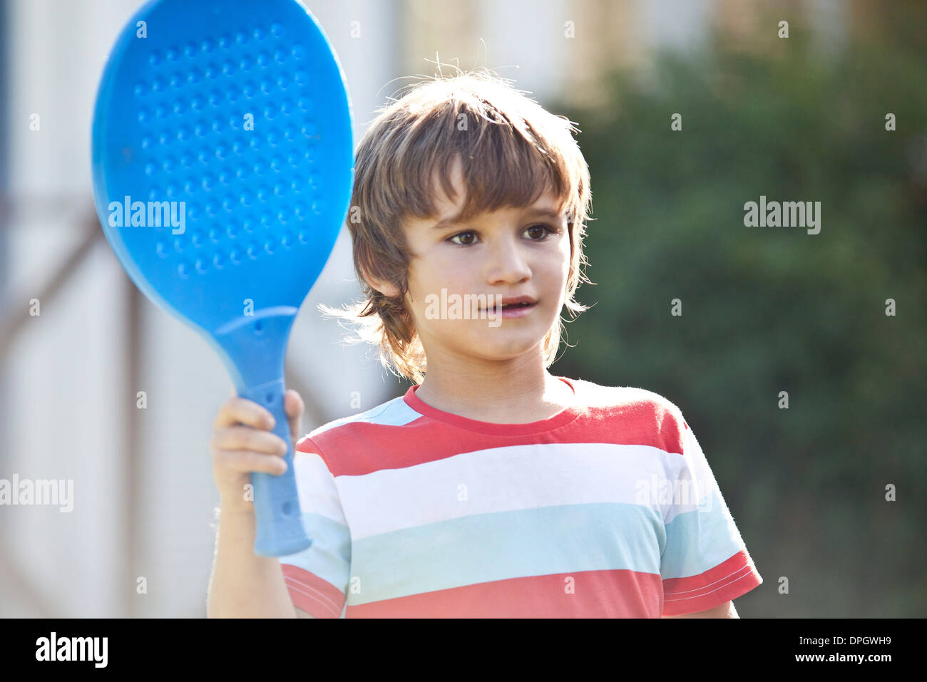 Boy holding racket - Stock Image