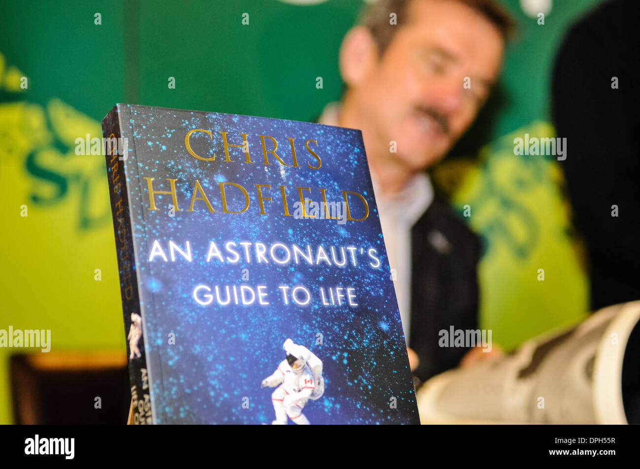 Belfast, Northern Ireland. 14 Jan 2014 -  Commander Chris Hadfield signs copies of his  book 'An Astronaut's Guide to Life on Earth' Credit:  Stephen Barnes/Alamy Live News - Stock Image