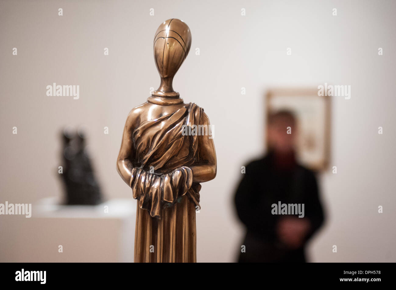 """London, UK - 14 January 2014: a gilded bronze sculture called """"The Disquieting Muse, 1970"""" is on display at the Stock Photo"""