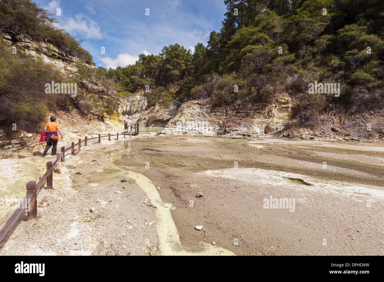 Tourists exploring Waiotapu Thermal Reserve, Rotorua, New Zealand. - Stock Image
