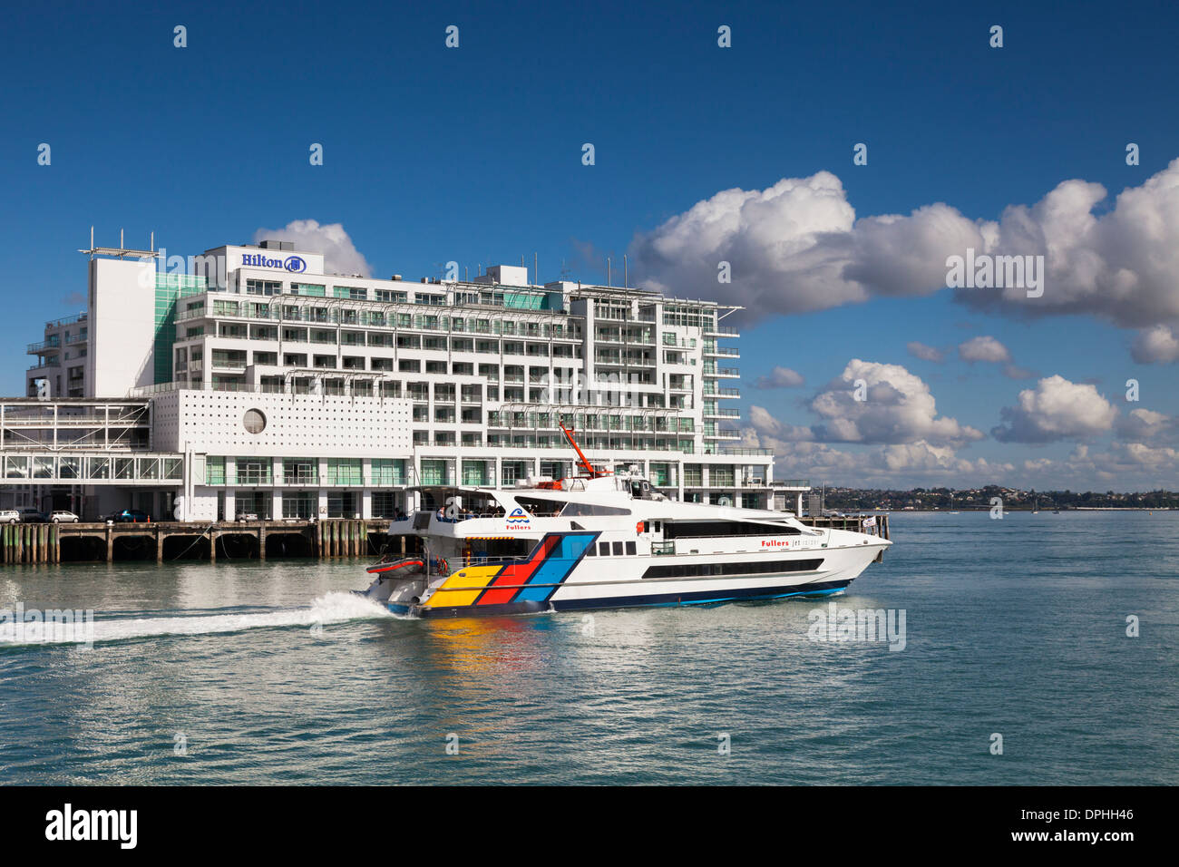 Fullers Ferry Passing Hilton Hotel, Auckland, New Zealand - Stock Image