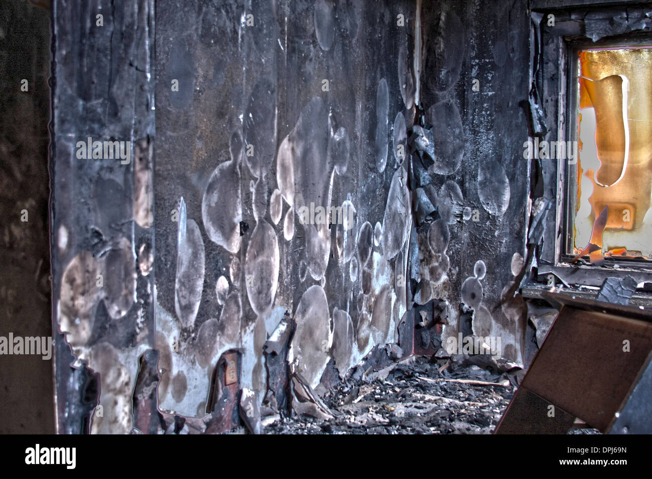 Room with fire smoke and water damage. Heat scorching on the wall - Stock Image