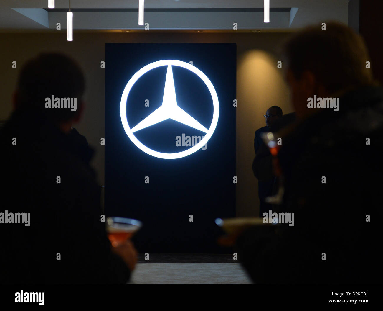 Detroit, USA. 12th Jan, 2014. The trhee-pinted star logo of Mercedes-Benz is pictured during the presentation of the new Mercedes-Benz C-Class in a hotel on the eve of the first press day of the North American International Auto Show (NAIAS) at Cobo Center Detroit in Detroit, USA, 12 January 2014. NAIAS will run from 13 till 26 January 2014, at first it will only be open for the press and car traders, later for the public as well. Photo: ULI DECK/DPA/Alamy Live News - Stock Image